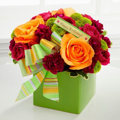 FTD the birthday bouquet is blend of orange roses and red carnations.