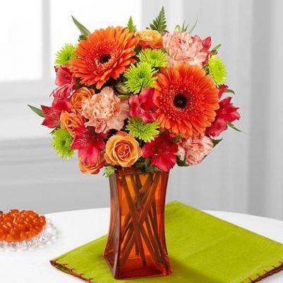 Orange Escape bouquet is wonderful wedding anniversary gift by Yonge flower shop.