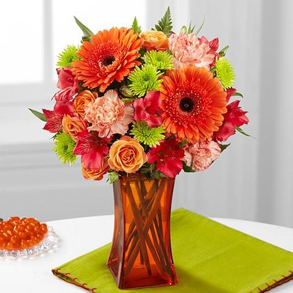 Orange Escape bouquet is wonderful wedding anniversary gift by Yonge flower shop.