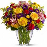 Birthday vase arrangement is a blooming garden for birthday celebrations.