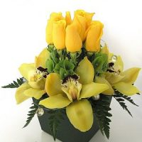 The cymbidium flowers and roses in black vase - Best floarl birthday gift.